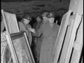 Gen. Dwight D. Eisenhower, Supreme Allied Commander, accompanied by Gen. Omar N. Bradley, left, CG, 12th Army Group, and Lt. George S. Patton, Jr., CG, US Third Army, inspects art treasures stolen by Germans and hidden in a salt mine in Germany.